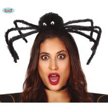 Černý pavouk na vlasové sponě